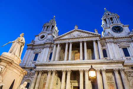 A dusk-time view of the facade of St. Pauls Cathedral in the City of London.