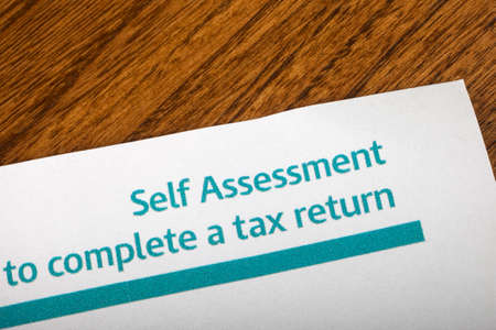 A piece of paper with a Self Assessment/Complete a Tax Return heading.