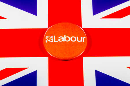LONDON, UK - MAY 2ND 2017: A Labour Party pin badge over the UK flag, on 2nd May 2017.