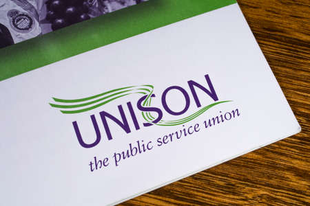 LONDON, UK - DECEMBER 18TH 2017: Close-up of the UNISON logo on a leaflet, on 18th December 2017.  UNISON is the second largest trade union in the UK.