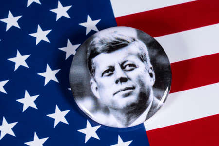 Photo for LONDON, UK - APRIL 27TH 2018: A John F. Kennedy badge pictured over the USA Flag, on 27th April 2018.  John F Kennedy was the 35th President of the United States of America. - Royalty Free Image