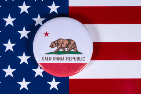 LONDON, UK - APRIL 27TH 2018: The symbol of the State of California, pictured over the flag of the United States of America, on 27th April 2018.