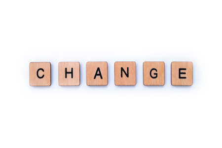 Photo for The word CHANGE, spelt with wooden letter tiles over a white background. - Royalty Free Image