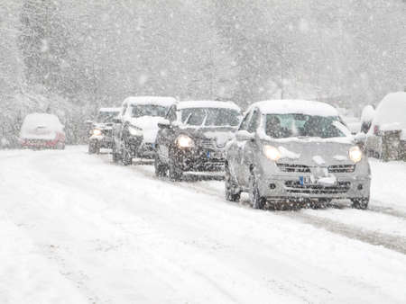 cars driving in heavy snow in england