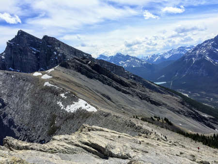 Hikers slowly making their way up to the top of Ha Ling Peak, outside of Canmore, in Alberta, Canada