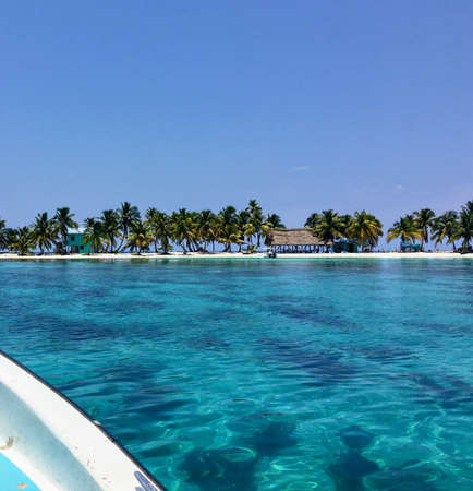 The view from a passenger travelling on a small boat to the the small tropical laughing bird caye off the coast of Belize.  A common spot for tourists who enjoy snorkelling and scuba diving.