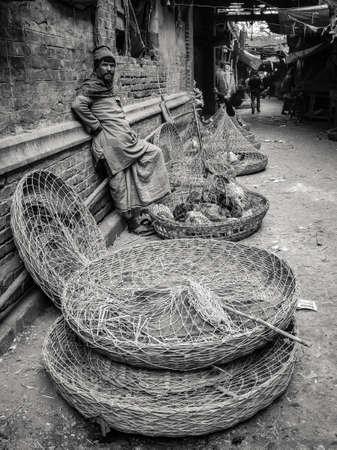 Foto de Men selling chickens at the street around an old market in kolkata, India. - Imagen libre de derechos