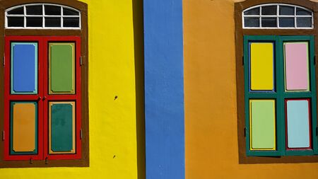 colorful old wooden window shutters in singapore
