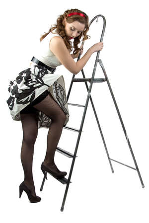 pin up woman down the stairs on white background