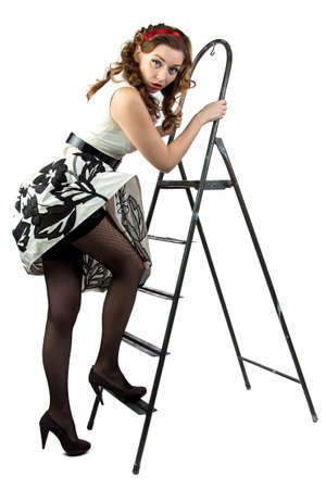 Image pin up woman down the stairs on white background