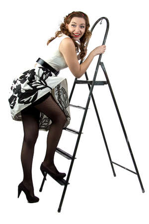 Portrait pin up woman down the stairs on white background