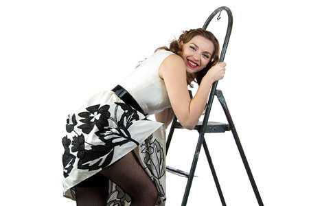Image smiling pin up woman down the stairs on white background
