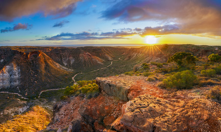Foto de panorama view of sunrise over charles knife canyon near exmouth, western australia - Imagen libre de derechos