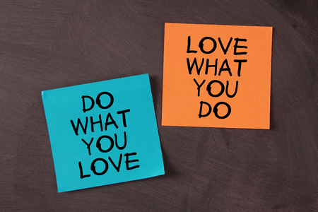 Photo pour 'Love What You Do and Do What You Love' notes pasted on blackboard. - image libre de droit