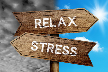 Foto de Relax Or Stress concept road sign with cloudy and sunny sky background. - Imagen libre de derechos