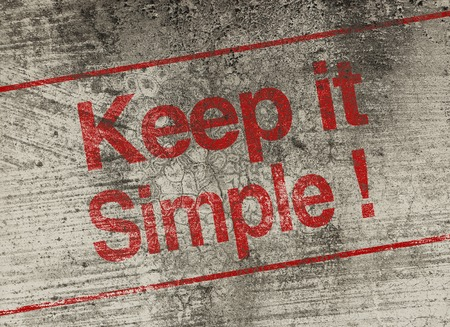 Keep it simple concept text is painted on old fashion wall.