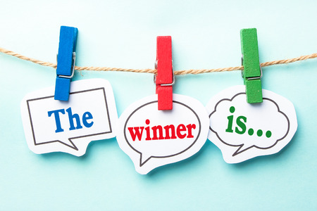 Photo pour The winner is concept paper speech bubbles with line on the light blue background. - image libre de droit