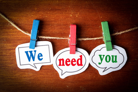 We need you concept paper speech bubbles with line on the wooden background.