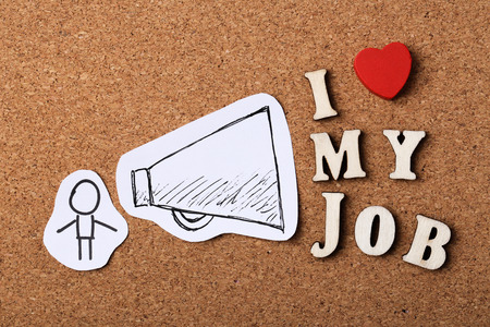Foto de I Love My Job concept on the wooden cork background. - Imagen libre de derechos