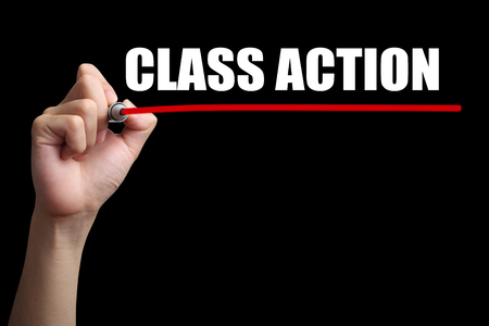 Photo pour Hand is drawing a red line under the text Class Action with black background. - image libre de droit