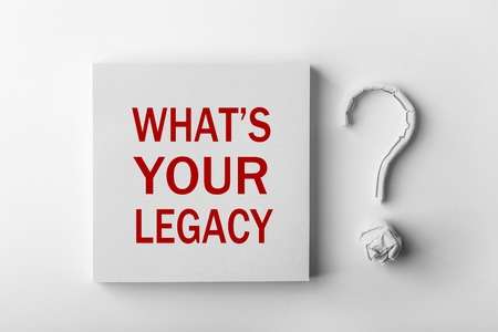 Photo pour Red text What is Your Legacy and paper question mark with white background. - image libre de droit