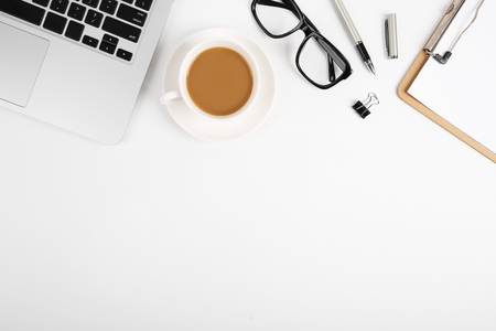 Photo for Workspace with blank clip board, laptop keyboard, office supplies, pen, glasses and coffee cup on white background. Flat lay, top view office table desk. - Royalty Free Image