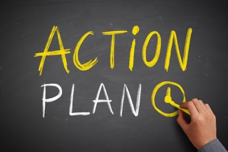 Photo pour Hand writes Action Plan  on the chalkboard - image libre de droit