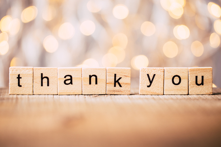 Foto de Thank you wooden blocks against shiny background. - Imagen libre de derechos