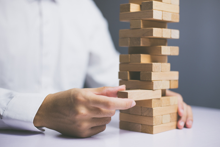 Photo pour Wooden block Planning, risk and strategy of project management in business, with hand pull wood block. - image libre de droit