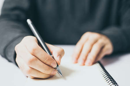 Photo pour Writing on the blank notebook with copy space. - image libre de droit