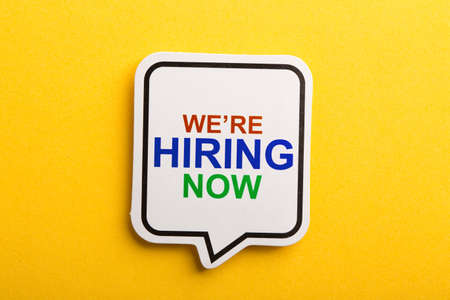 Photo for We Are Hiring speech bubble isolated on yellow background. - Royalty Free Image