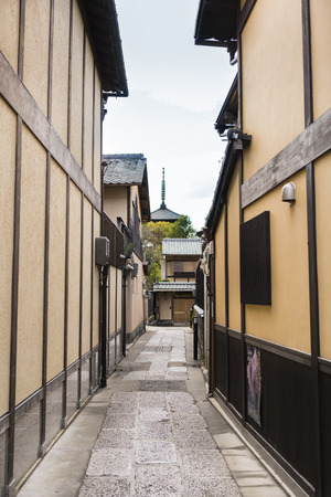 Traditional Street in Kyoto, Japan with distant temple spire. Vertical format