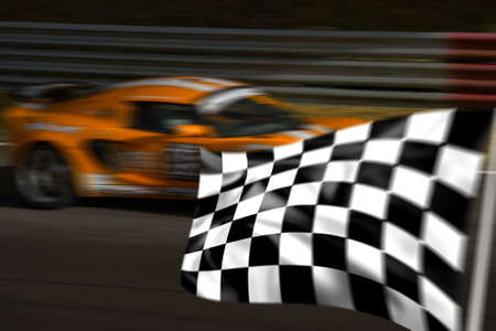 Orange racing car passing a chequered flag with motion blur