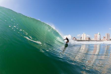 Surfing surfer rides ocean wave at North Beach Durban South-Africa