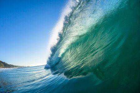 Photo pour Ocean swimming closeup inside hollow crashing wave water towards camera lens. - image libre de droit