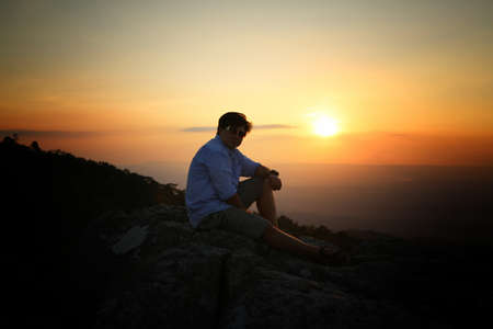 Photo pour a man on a mountain top. Person on the rock. Sport and active life concept. Beauty world. - image libre de droit