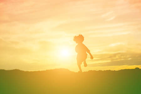 Photo for kid silhouette,Moments of the child's joy. On the Nature sunset - Royalty Free Image