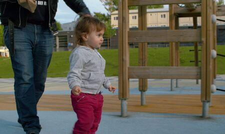 Photo for Baby girl on the playground in the park - Royalty Free Image
