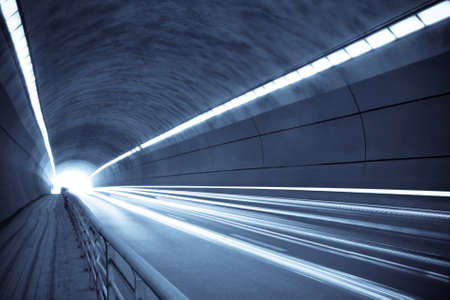 traces of light and motion blur of tunnel in blue tone