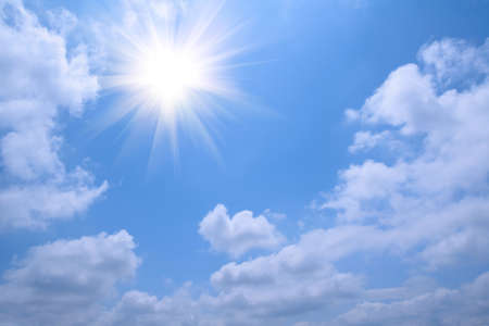 background of blue sky and white cloud and radiant sun