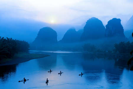 sunrise with bamboo raft  at Yangshuo on the Li River, China