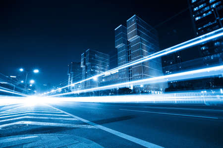 light trails on the modern city  at night  in beijing,China