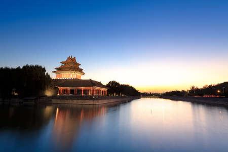 the turret of beijing forbidden city at dusk