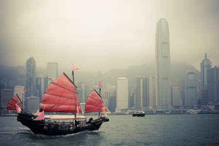 traditional wooden sailboat sailing in victoria harbor,Hong Kong.