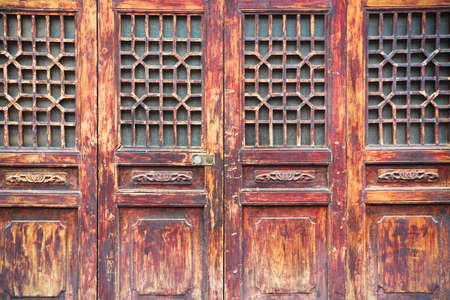 chinese traditional wooden door with a beautiful lattice window