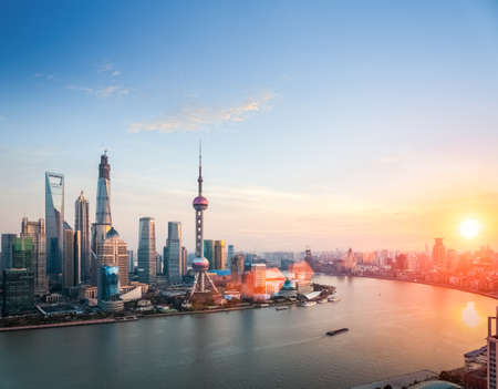 beautiful shanghai at dusk ,  huangpu river and financial district skyline in sunset