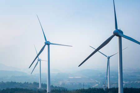 wind farm closeup ,new energy with fog and haze weather