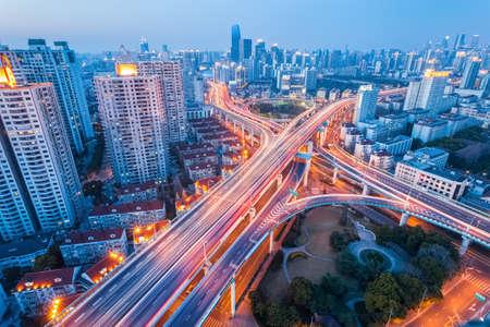 city interchange at nightfall in shanghai, modern transport infrastructure background