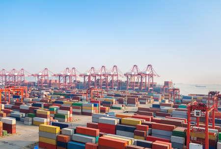 Foto de shipping container terminal at dusk,  modern harbor and global trade background - Imagen libre de derechos