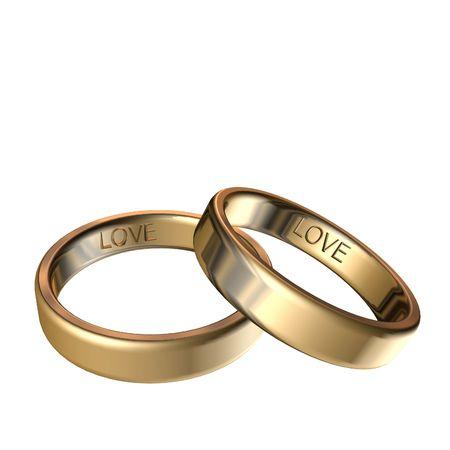 Foto de Golden rings with engraved love 3D rendering - Imagen libre de derechos